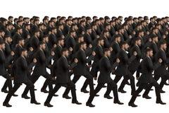 Cloni in marcia su fondo bianco Fotografie Stock Libere da Diritti