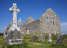 Clonmacnoise Cathedral with the typical crosses and graves. The monastery ruins. Ireland Royalty Free Stock Photography