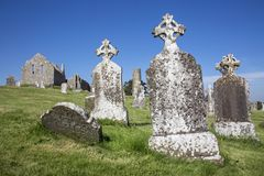 Clonmacnoise Cathedral with the typical crosses and graves. The monastery ruins. Ireland royalty free stock images