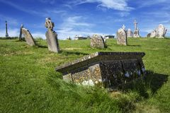 Clonmacnoise Cathedral with the typical crosses and graves. The monastery ruins. Ireland stock image
