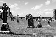 Clonmacnoise stone crosses. Clonmacnoise, Shannonbridge, County Offaly, Ireland. High stone crosses and round tower Stock Photos