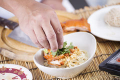 Cloose up hand of Chef cooking Noodle Stock Images