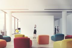 Clored armchairs office classroom, woman Royalty Free Stock Image