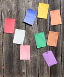 Clored papers and paperclip. Some colored papers with paperclips on the wood Stock Photo
