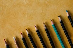 Colored pencils on a textural paper background of yellow color copy space stock photography