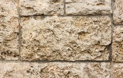 Beige stonewall texture 1. Clos up of beige stone wall texture background surface Royalty Free Stock Photography