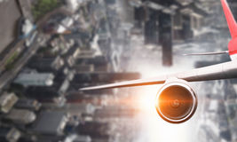 Close of airplane in sky. Mixed media Stock Photos