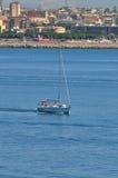 Close boat sailing near Cagliari marina. Royalty Free Stock Photography