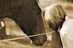 Close bond between woman and horse. Woman and horse showing close friendship, trust and bond they share between them Royalty Free Stock Image