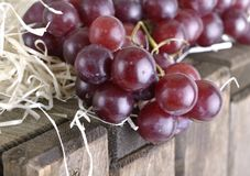 Bunch of grapes on a wooden box Royalty Free Stock Photos