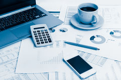 Close of business workplace with financial reports and office st Royalty Free Stock Photos
