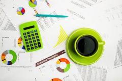 Close of business workplace with financial reports Stock Image