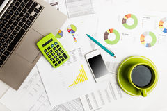 Close of business workplace with financial reports Stock Images