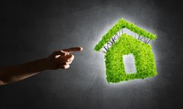 Concept of eco architecture presented by green house on dark background Royalty Free Stock Images