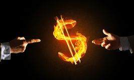 Concept of money making with dollar currency fire symbol on dark background Stock Photos