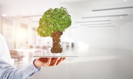 Eco green environment concept presented by tree as working mechanism or engine stock photography