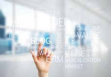 Concept of modern business with palm choocing on of keywords for success Stock Images
