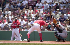 Close Call. Boston Red Sox hitter Nomar Garciaparra is able to get under a pitch without getting hit by it.   Image taken from a color slide Stock Photography
