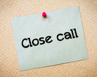 Close Call. Message. Recycled paper note pinned on cork board. Concept Image Royalty Free Stock Images