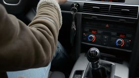 Close car cabin girl hand with ring shifts gears in auto. Hd footage stock video footage