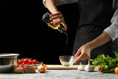 Close the chef& x27;s hands, preparing an Italian tomato sauce for macaroni.pizza. The concept of the Italian cooking recipe stock photos