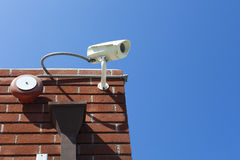 Close circuit security camera. Closed circuit television security camera attached to the brick wall. Extra space for copy stock image