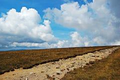 Close Clouds. An mountain road in Bucegi Mountains stock image