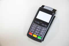 Close credit card swiping machine to pay. Credit card swipe through terminal for payment in cafeteria Stock Photos