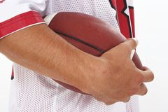 Close Crop of Man in Jersey Holding Football Royalty Free Stock Images