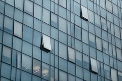 Close crystal building. Facade photo. Sky scrapper windows close-up in a cloudy day Stock Images