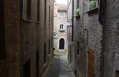 Close dark alley in Urbino – Italy stock image