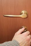 Close door. A man is closing door by key. It could be used as metaphor means the closing of negotiation in business field, or as way that is going to be open/ Royalty Free Stock Photo