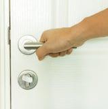 Close door knob. Hand to opening close door knob stock image