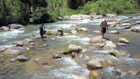 Close Drone View Men Fish in Shallow Water among Rapids. NHA TRANG/VIETNAM - AUGUST 26 2017: Close drone view local men catch fish with electric rods and landing stock footage