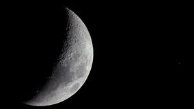 Close encounter between the Moon and Saturn Royalty Free Stock Photo