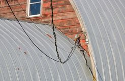 Electrical Wiring for Farm Building. Close, exterior view of electrical wiring used to power a rural farm building stock photo