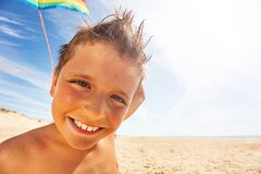 Free Close Face Portrait Of The Boy With Kite On Beach Royalty Free Stock Images - 168837389