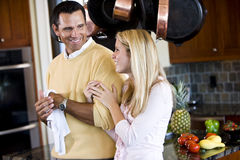 Close father and teen daughter chatting in kitchen stock images