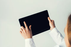 Close of female doctor hands working with tablet pc computer Stock Photo