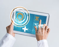 Close of female doctor hands working with tablet pc computer Stock Photos
