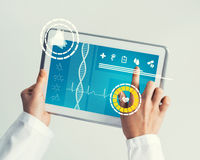 Close of female doctor hands working with tablet pc computer Stock Photography