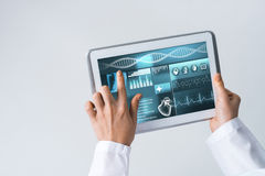 Close of female doctor hands working with tablet pc computer Stock Image