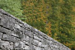 Close focus on a stacked stone wall Stock Image