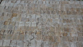 A really close footage of the close-up view of the old cabin cedar wooden shingle shake roof stock footage