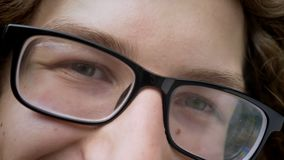 Close footage of handsome man`s eyes in glasses looking at camera and smiling, smart look of successful student stock video footage