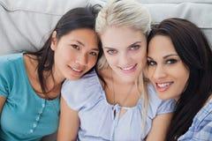 Close friends smiling at camera Stock Photo