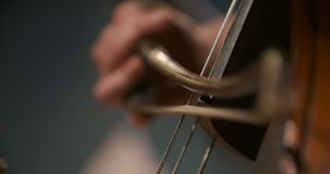 Cello in orchestra. Musician playing Cello stock video footage