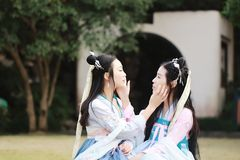 Close girlfriends bestie in Chinese traditional ancient costume. Close girlfriends bestie in Chinese traditional hanfu dress in a garden, ancient chinese hanfu Stock Images