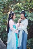 Close girlfriends bestie in Chinese traditional ancient costume Stock Image