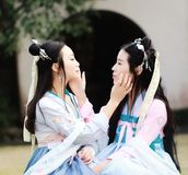 Close girlfriends bestie in Chinese traditional ancient costume Stock Photos